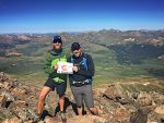 A friend and I celebrating the summit of Mount. Bierstadt.
